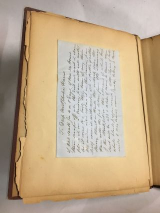 Scrapbook containing individual recipes in French and English.